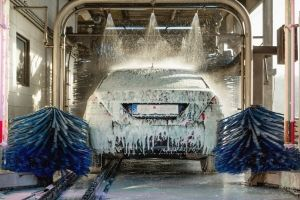 car gets cleaned through an automatic car wash